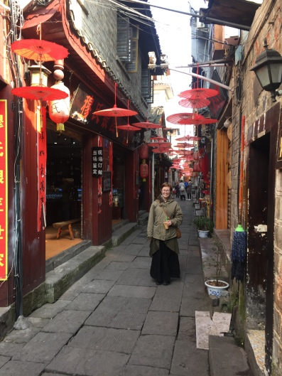Side street in Fenghuang with hanging decorations